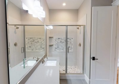 Tile Shower with Custom Floor and Decoration