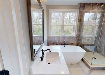 Beautiful Bath with Custom Tile work and mixing metal colors